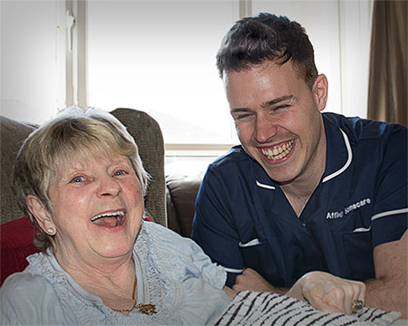 carer and client smiling for the camera
